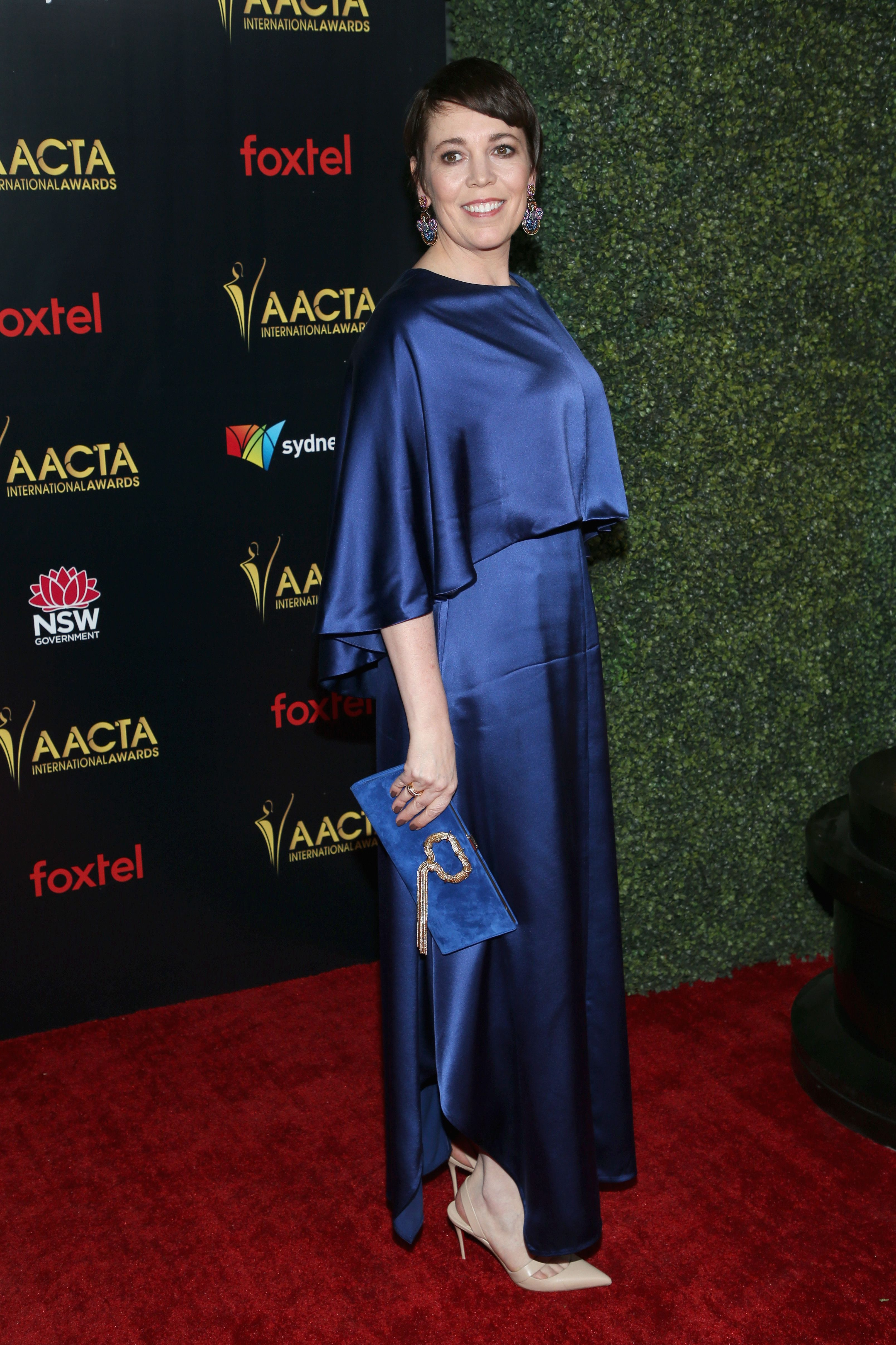 The British actress looked sophisticated in a silk gown by Varana , statement earrings, and a blue suede clutch at the AACTA International Awards in L.A.