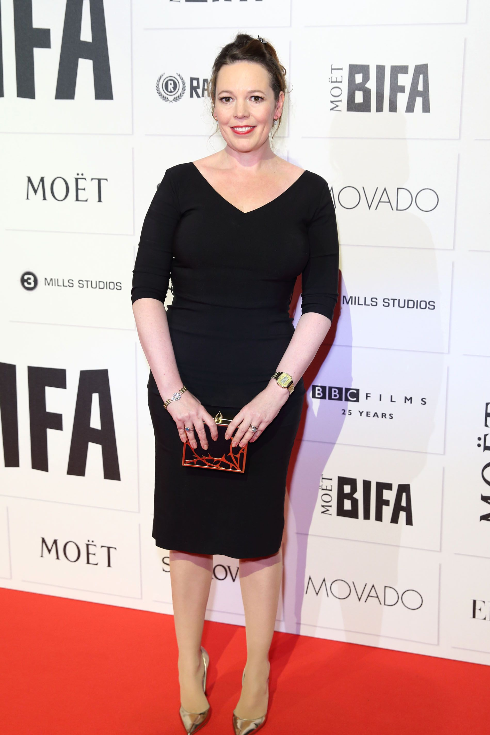Olivia paired a simple black dress with gold pumps and a unique black-and-red clutch to attend the Moet British Independent Film Awards.