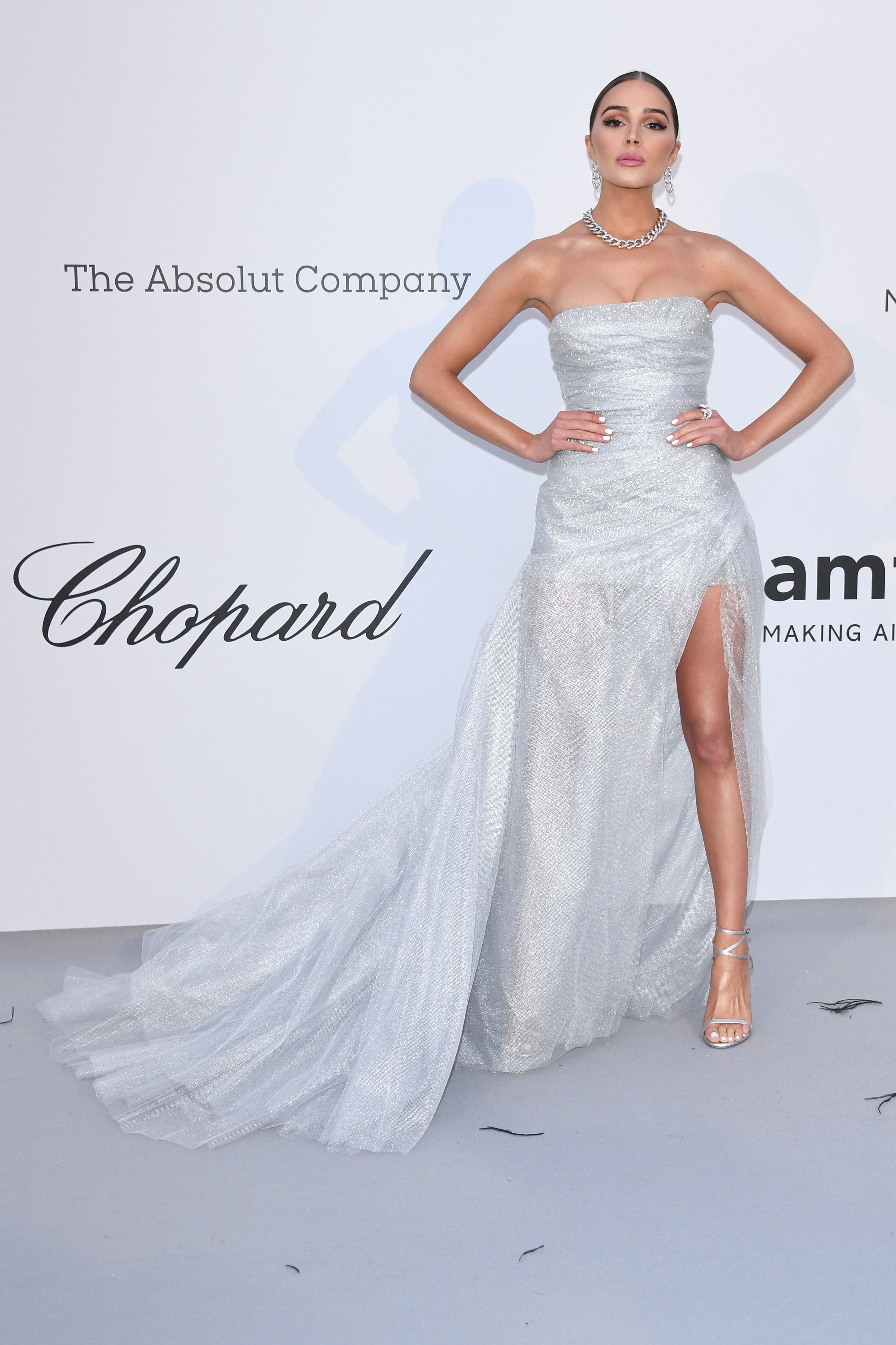Olivia Culpo In a white strapless gown with a high-leg slit.