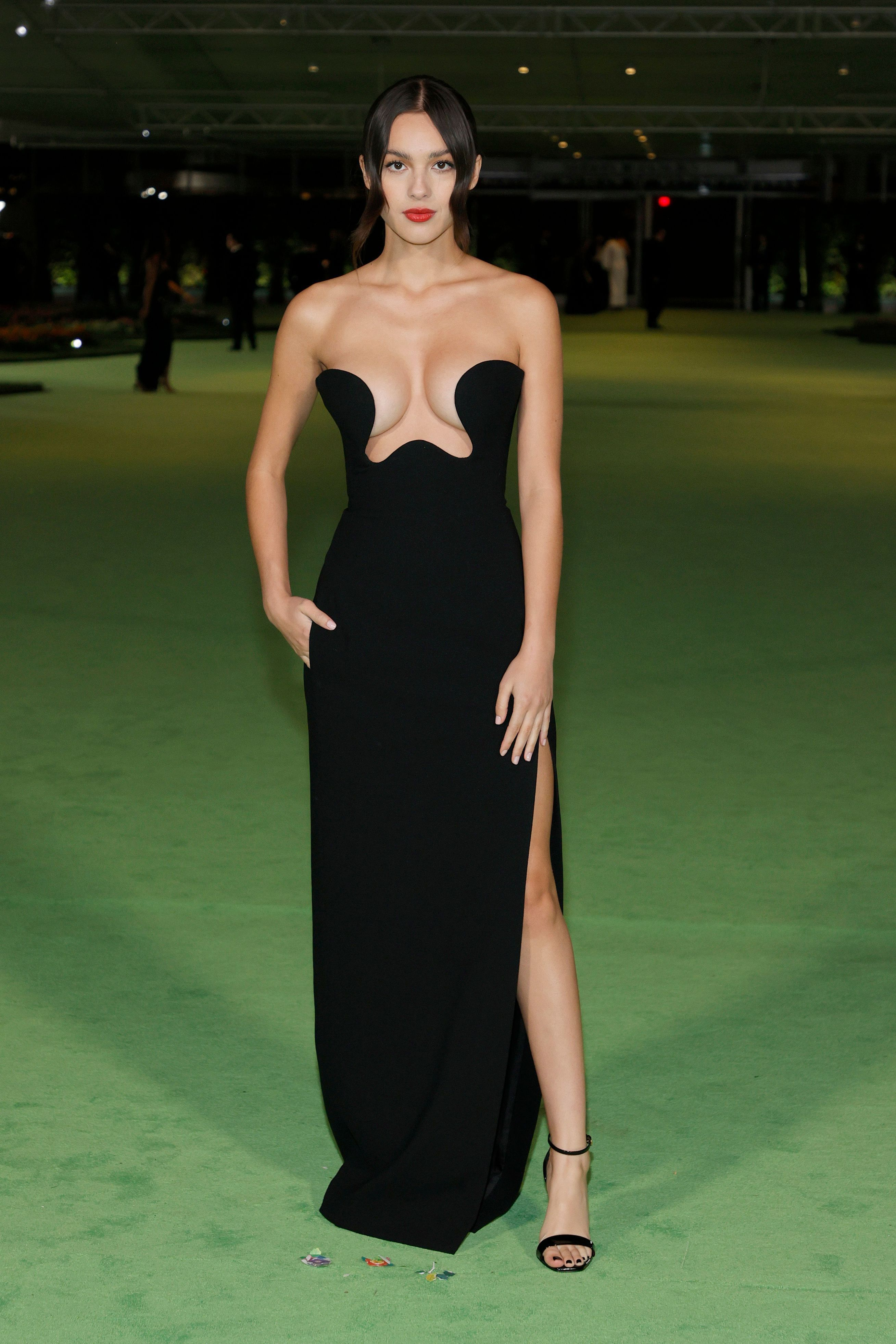 Olivia Rodrigo Stunned in a Plunge Saint Laurent Black Gown at the Academy Museum of Motion Pictures Gala