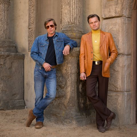 Jeans, Denim, Standing, Fashion, Jacket, Outerwear, Leather jacket, Suit, Textile, Trousers,