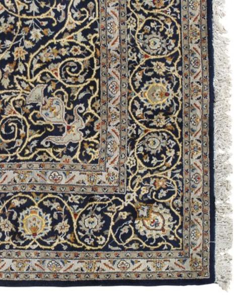 vintage rug with tassels