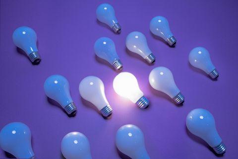 one lit lightbulb among many