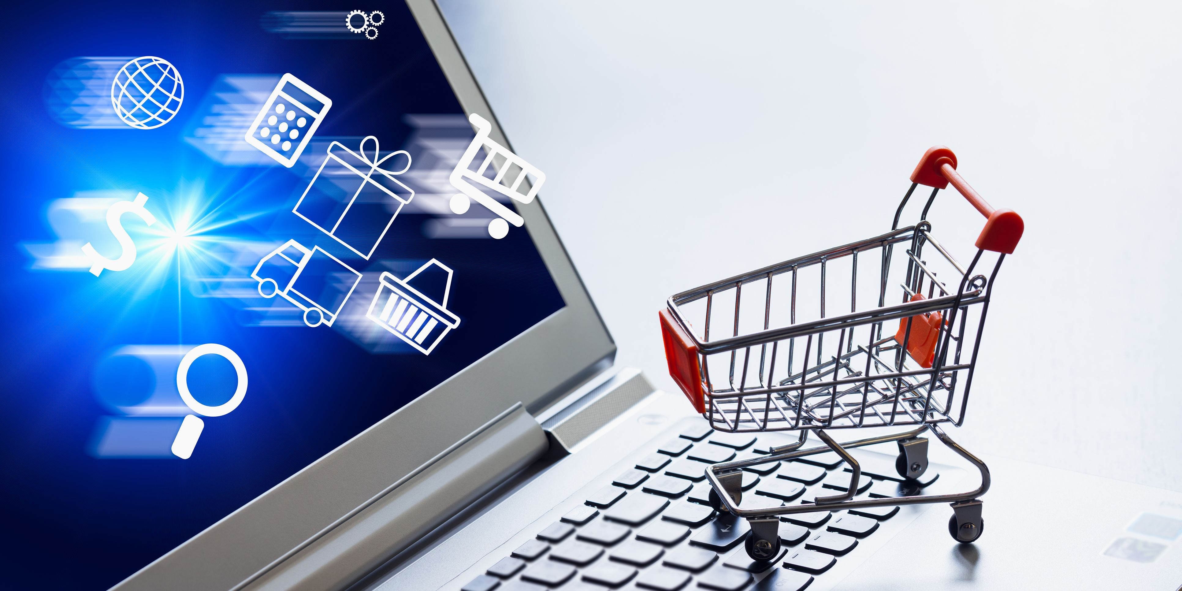 Online shopping concept. Shopping apps icons in shopping cart on laptop