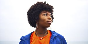 portrait of woman looking off camera with colourful clothing