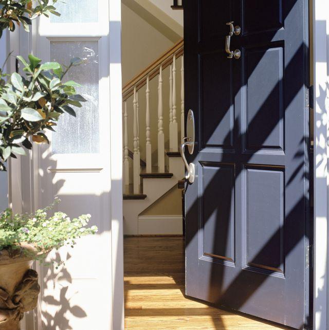 open blue front door of house