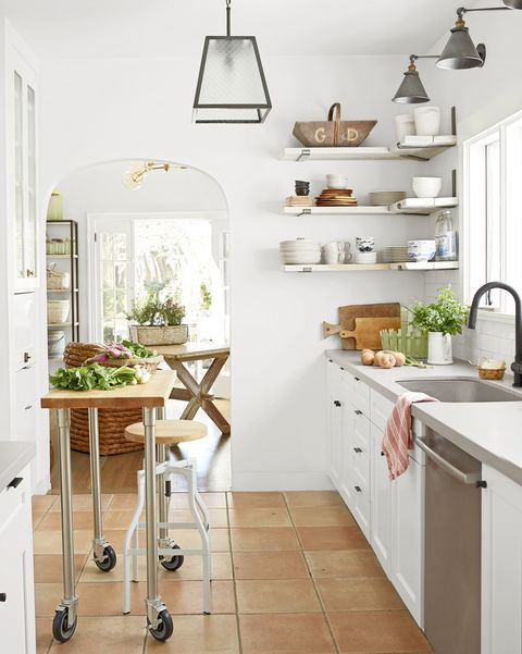 white kitchen in small spanish style california cottage
