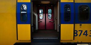 Open Doors Of Train By Railroad Platform