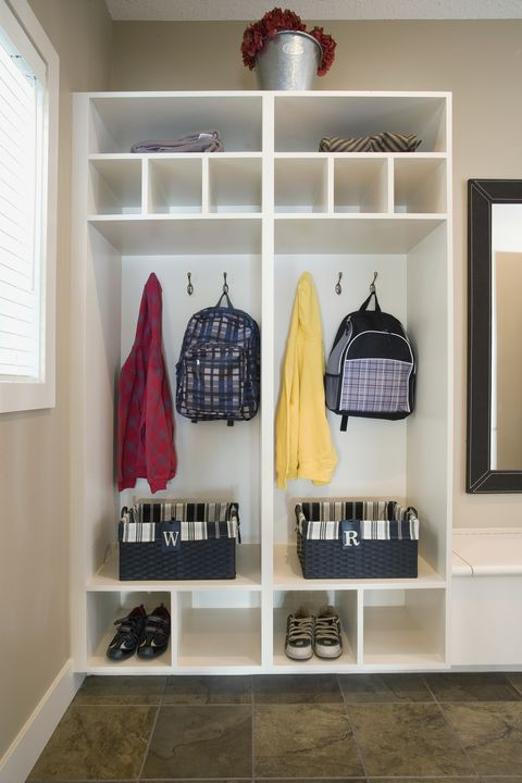 Get the kids to school on time - Open shelved closet with backpacks and baskets