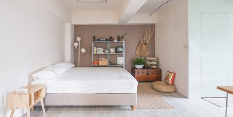 Open space interior with a bedroom corner