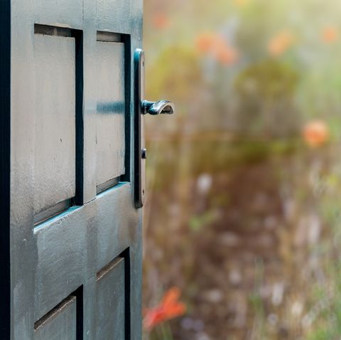 Opened door concept to beautiful and imaginary poppies field