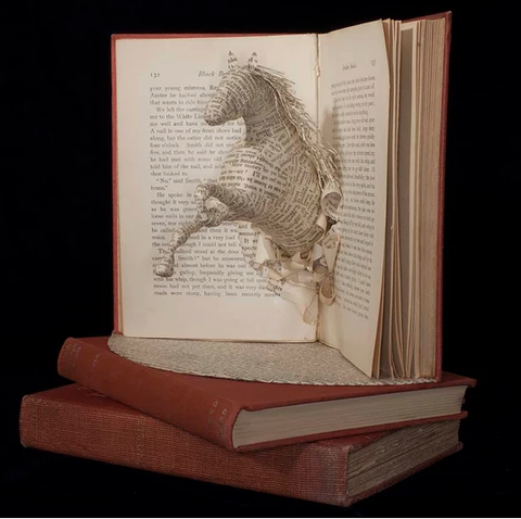 Artist Creates Sculpture from Pages of Books