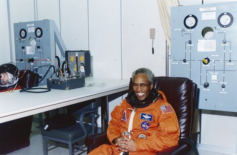a relaxed and smiling sts 39 mission specialist guion s bluford jr dons his partial pressure suit in the operations and checkout building, kennedy space center, florida, april 28, 1991 bluford, the first african american in space, first went to space in 1983 photo by nasainterim archivesgetty images