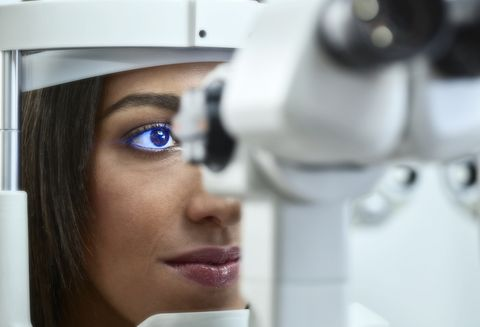 Optician, Young woman during eye test