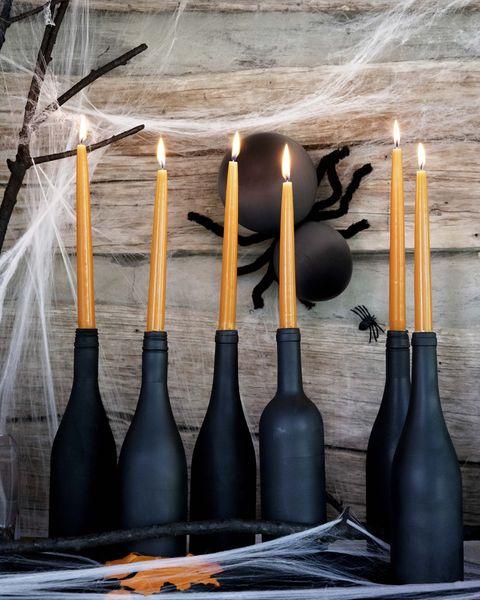 orange candles and black wine bottles