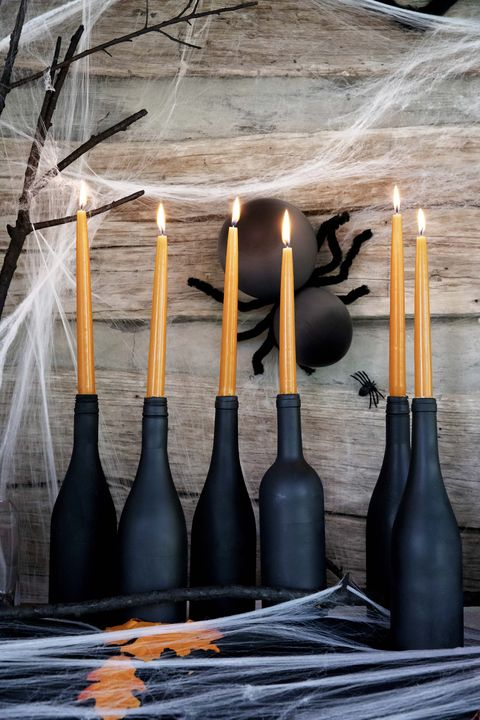 orange candles and black wine bottles