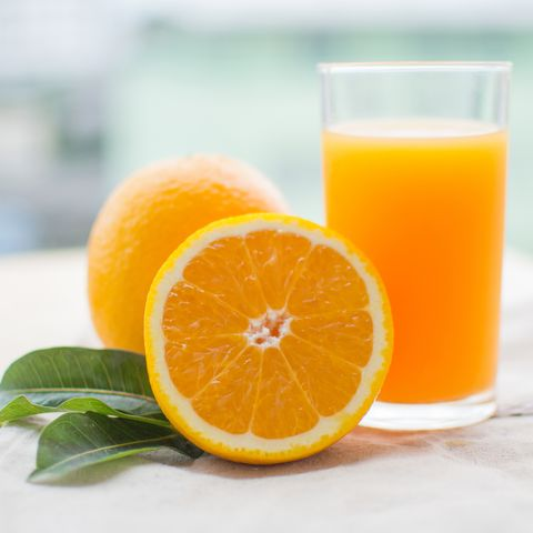 Orange Fruit And Juice In Glass On Table