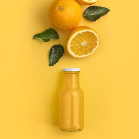 Orange fruits and juice in bottle.