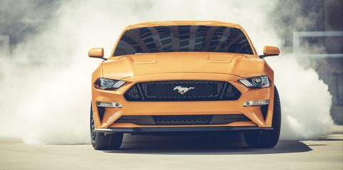 Land vehicle, Vehicle, Car, Motor vehicle, Tire, Automotive design, Automotive tire, Sky, Yellow, Automotive exterior,