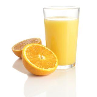 Orange juice and fresh orange