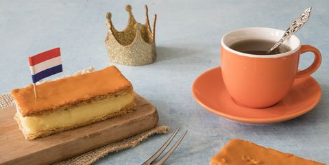 orange tompouce, traditional dutch treat with pudding and frosting on national holiday kings day april 27th, in the netherlands