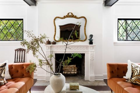 family room with fireplace and orange sofas