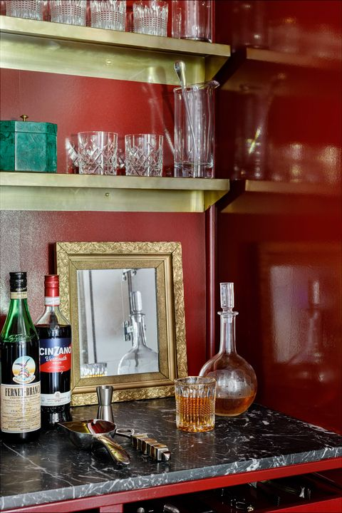 bar, red walls, black and white marble countertops