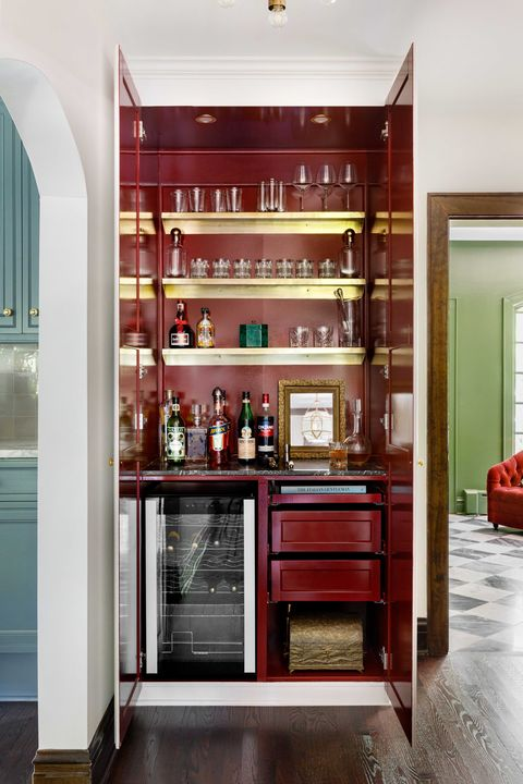 bar with red walls, black and white countertops