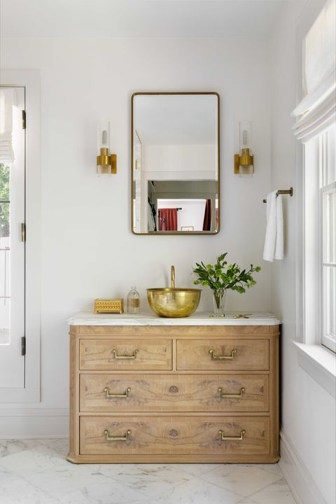 main bathroom, wooden cabinet with white marble countertop, gold sink with gold faucet