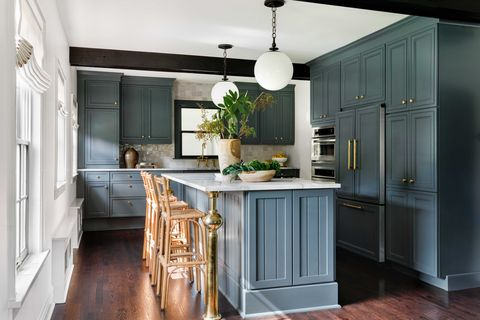 kitchen, dark teal cabinets with white countertops, rattan bar chairs
