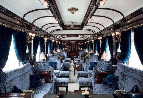 Transport, Interior design, Textile, Ceiling, Interior design, Light fixture, Public transport, Train, Curtain, Window treatment,