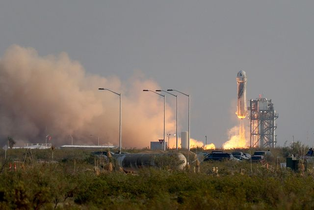 van horn, texas   july 20  the new shepard blue origin rocket lifts off from the launch pad carrying jeff bezos along with his brother mark bezos, 18 year old oliver daemen, and 82 year old wally funk prepare to launch on july 20, 2021 in van horn, texas mr bezos and the crew are riding in the first human spaceflight for the company   photo by joe raedlegetty images