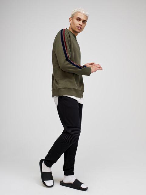 Standing, Shoulder, Arm, Footwear, Joint, Outerwear, Leg, Sleeve, Shoe, Trousers,