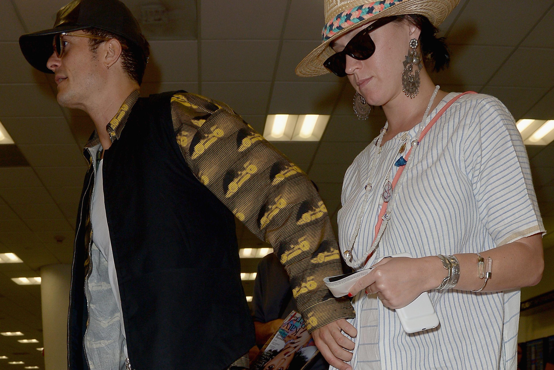 Katy Perry And Orlando Bloom Sighting At Miami International Airport