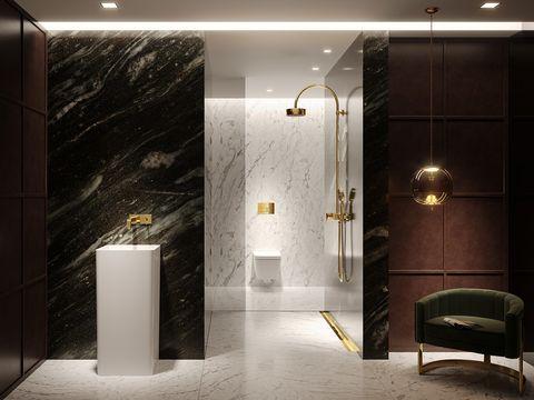 baño decorado con apliques y accesorios dorados