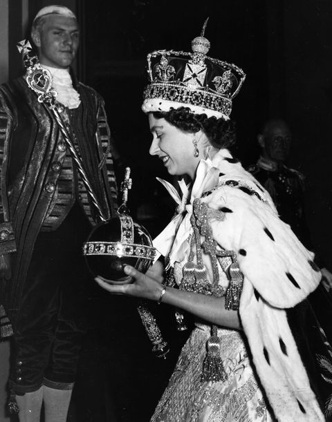queen elizabeth ii wearing the imperial state crown and carrying the orb and sceptre, leaving the state coach and entering buckingham palace, after  the coronation  original publication picture post   6537   the coronation of queen elizabeth ii   pub 1953   photo by hulton archivegetty images