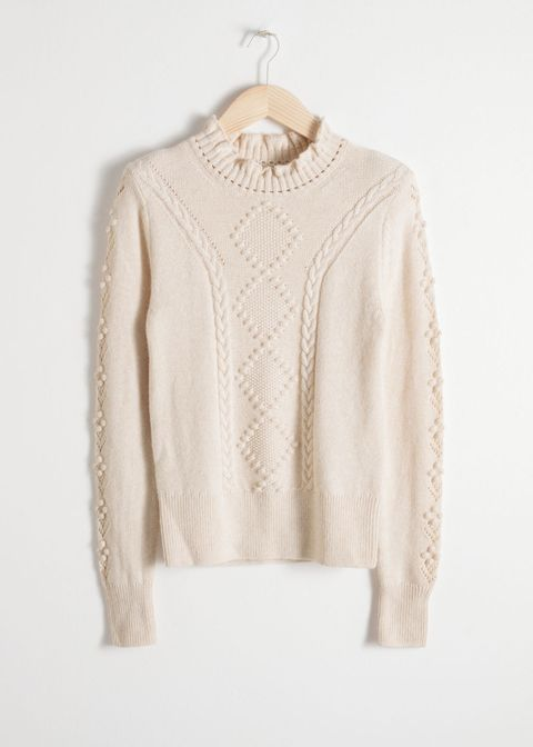 Clothing, White, Outerwear, Sleeve, Beige, Neck, Top, Blouse, Sweater, Clothes hanger,
