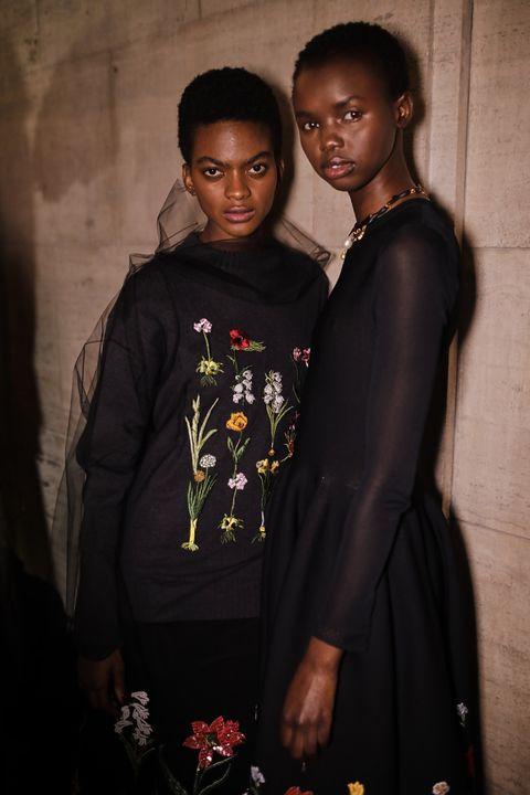 Black, Child, Adaptation, Smile, Formal wear,