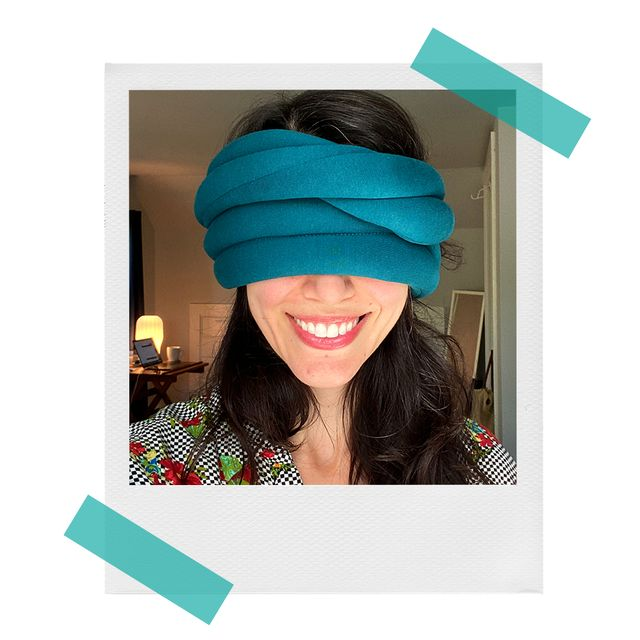 ostrich loop pillow wrapped around melanie's eyes