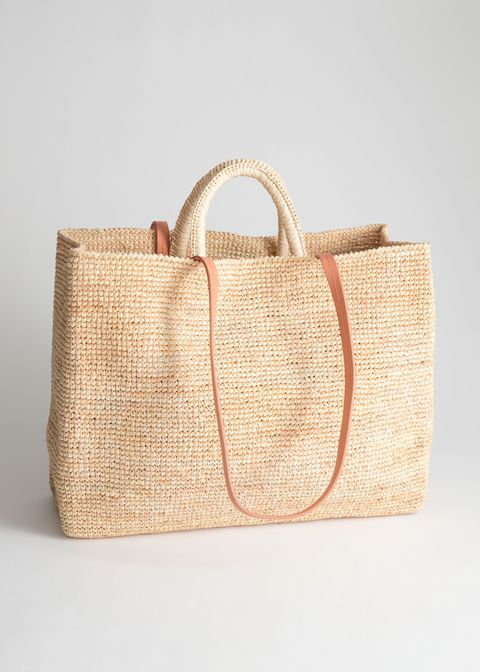 other stories large woven straw tote with a leather strap and inner patch pocket compartment