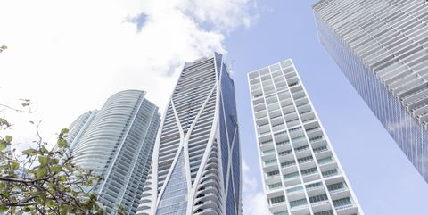 Metropolitan area, Skyscraper, Tower block, Daytime, Building, Commercial building, Architecture, Condominium, Urban area, City,