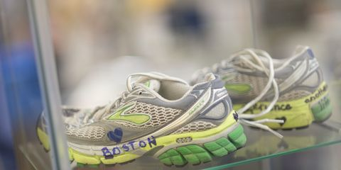 Running shoes that are part of a Boston Marathon memorial exhibit