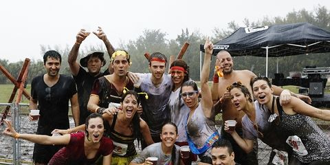 Runners celebrate after an Out-Fit event