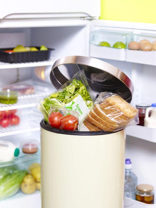 out of date food in garbage bin in front fridge