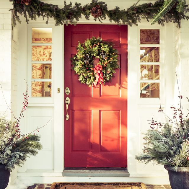 exterior red door decorated for christmas
