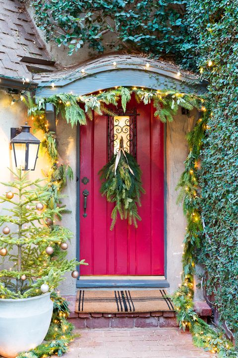 red front door decorated for the holidays
