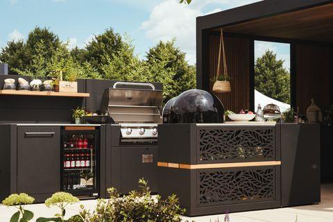 outdoor kitchen, outdoor modular kitchen made in aluminium power coated steel with iroko wood detailing, garden house design at hampton court palace flower show
