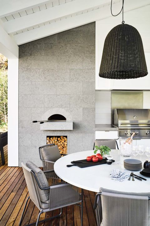 outdoor kitchen with wood decking and pizza oven