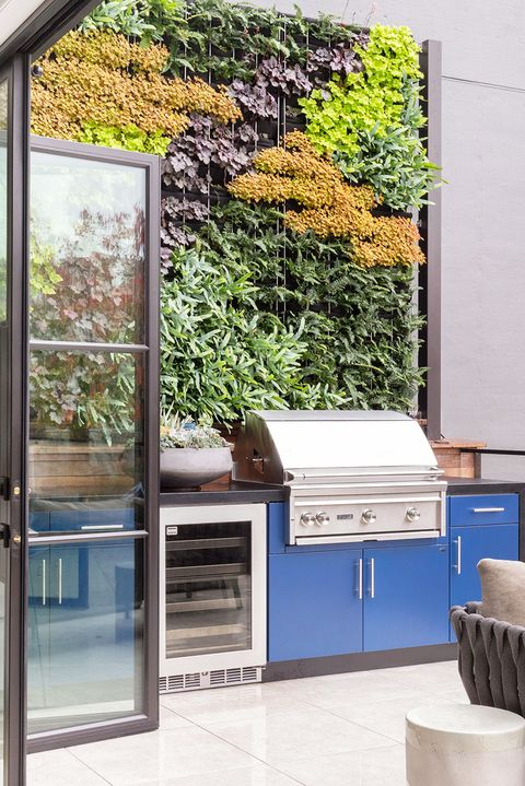 blue outdoor grilling and patio area