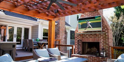 An Outdoor Tv Will Instantly Upgrade Your Backyard Entertainment